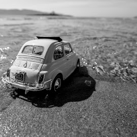 How is the water? by Grigoris Koulouriotis - Artistic Objects Toys ( water, car, sand, toy, black and white, sea, beach, fiat500,  )