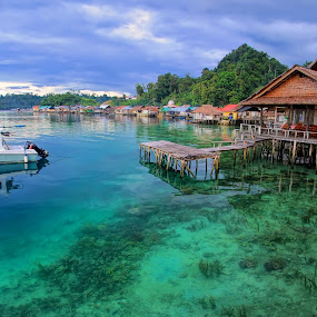 The Sawai Resort  by Alvin Lee Hahuly - City,  Street & Park  Vistas ( resort water boat bridges corals sea village )