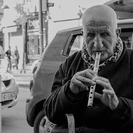 The blind musician  by Naser Eid - People Street & Candids ( old, black and white, flute, street, musician, people, blind, portrait, man )