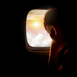 by T Sco - People Street & Candids ( looking, clouds, sky, plane, deep thoughts, thought, travel, morning, sun )