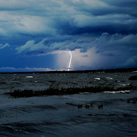 It was beautiful down by the lake tonight. But an angry lake it was at Nalcrest. by Carl Rader - Landscapes Weather
