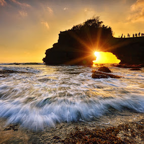 The Eyes by Hendri Suhandi - Landscapes Sunsets & Sunrises ( temple, bali, batu bolong, sunset, tanah lot, sunrise, beach, flare )