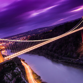 Clifton Suspension Bridge by Sinclair Parkinson - Buildings & Architecture Public & Historical ( canon, gorge, clifton, canon 7d, pwcbridges, lights, brunel, england, somerset, fat spanner photography, trail, long exposure, trails, light, bristol, clouds, uk, sinclair parkinson, suspension, avon, urban, tower, 7d, great britain, sunset, clifton suspension bridge, cloud, night, bridge, river, britain, , city at night, street at night, park at night, nightlife, night life, nighttime in the city )