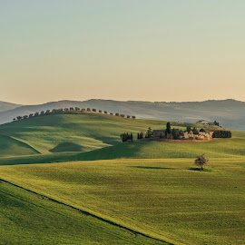 Tuscany countryside at Sunset by Aleš Krivec - Landscapes Prairies, Meadows & Fields ( countryside, hills, tuscany, grass, landscape, rural, sun, country, farm, field, nature, villa, sunset, cottage, meadow, cypress, scenery, tuscan, evening, italy )