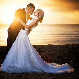 Kiss 9780 by Keith Darmanin - Wedding Bride & Groom ( wedding photos destination, wedding photography, keith darmanin #kitzklikz, kitz klikz, malta, sunset, weddings, wedding, wedding dress, beach, wedding photographer, keith darmanin )