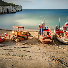 Days End by Darrell Evans - Transportation Boats ( water, clouds, sand, old, vehicle, boats, cliff, sea, equipment, ocean, beach, landscape, coast, bulldozer, chain, yorkshire, outdoor, cliff-face, cove, tractor )