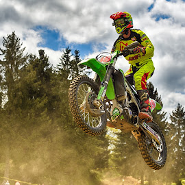 Jump'n Dust by Marco Bertamé - Sports & Fitness Motorsports ( clouds, speed, green, yellow, race, noise, jump, flying, motocross, blue, dust, cloudy, air, high )