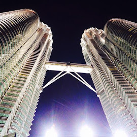 Petronas Twin Tower at Night by Roan Biguasen - Buildings & Architecture Architectural Detail ( building, symmetry, city park )