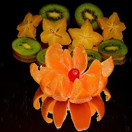 Kiwi, star fruit and tengerine. by Andrew Piekut - Food & Drink Fruits & Vegetables