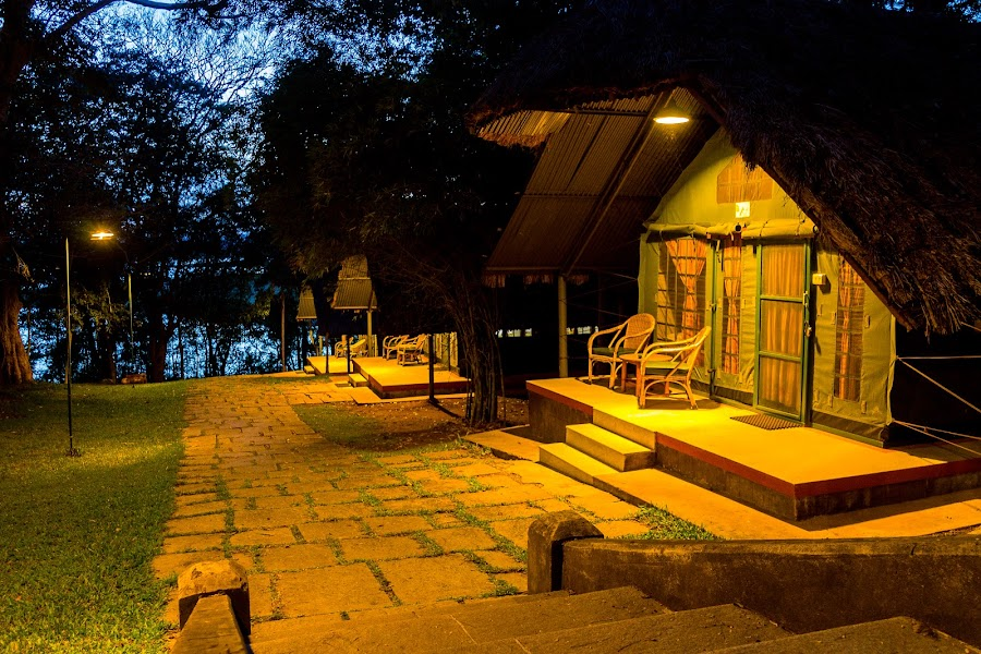 Home on the river front by Gurucharan Shamji - Buildings & Architecture Homes ( home, tent, night, river front, lodge )