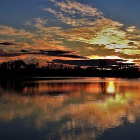 Glow-orange by Kathy Woods Booth - Landscapes Sunsets & Sunrises ( waterscape, sunset, cloudscape, reflections, dusk )