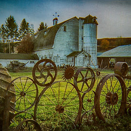 The Farm Fence by Guy Shultz - Buildings & Architecture Architectural Detail ( farm, fence, palouse, iron wheels, barn, silo )