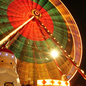 big wheel by Danny Charge - Public Holidays Christmas ( exposure, wheel, santa, long, big, colours )
