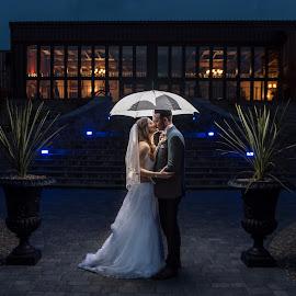 Under The Umbrella of Love by Nigel Hepplewhite - Wedding Bride & Groom ( love, wedding, umbrella, couple, symmetry, bride and groom )