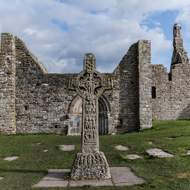 Clonmacnoise by John Holmes - Buildings & Architecture Places of Worship ( medival, walls, ireland, monastery, chistian, stone, gravestones, celtic cross, ruins, clonmacnoise, ancient east, crosses, historic )