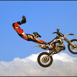 Catching a Ride by Craig McNiven - Transportation Motorcycles ( clouds, flight, bike, motorbike, stunt,  )