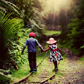Tramline Walk by Jomy Jose - Babies & Children Child Portraits ( green, forest, tramline, kids, light )
