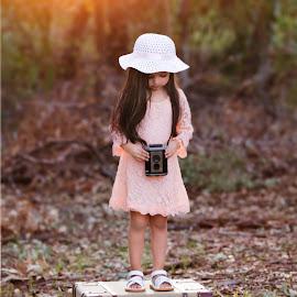 Possibilities by Liz Straight - Babies & Children Child Portraits ( portraiture, natural light, girl, dress, outdoors, camera, children, kids, portrait, hat )