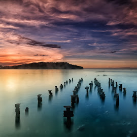 Song of the Broken Pier by Ina Herliana Koswara - Landscapes Waterscapes ( water, sky, pier, long exposure, sunrise )
