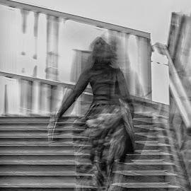 On the stairs by Jose Hernan Cibils - City,  Street & Park  Street Scenes ( stairs, metro, woman, street, berlin, black&white )