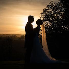 Evening Afterglow... by Nigel Hepplewhite - Wedding Bride & Groom ( sunset, silhouette, dress, wedding, veil, bride, groom )