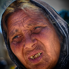 Old woman in Montmatre, Paris by Marthinus Strydom - People Street & Candids ( paris, montmatre, old, beggsr, sadness, woman, pain, france, refugee )