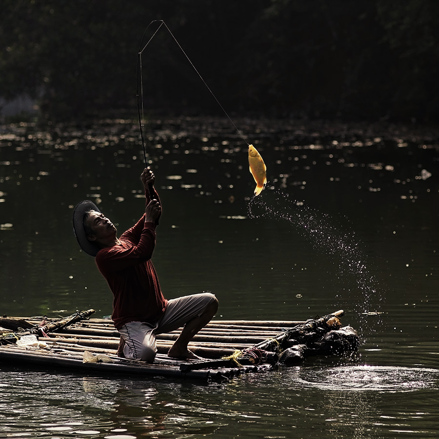 The Angler by Lucky E. Santoso - People Portraits of Men