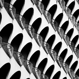 Balconies of a hotel by Péter Mocsonoky - Buildings & Architecture Other Exteriors ( abstract, motel, pattern, white, round, hotel, shape, black, balcony )