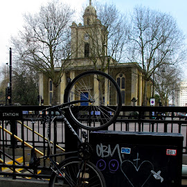 Two Wheels and a Church by DJ Cockburn - Transportation Bicycles ( church, substation, central line, bethnal green, exit, st john on bethnal green, bicycle, london underground, john sloane, east london, england, bethnal green road, graffiti )