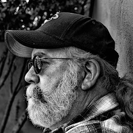 Thousand Mile Stare by Donna Underwood - People Portraits of Men ( grey hair, baseball cap, black and white, 60's, plaid, reflections, beard, vietnam vet, men, portrait,  )