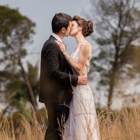 Summer Kiss by Lood Goosen (LWG Photo) - Wedding Bride & Groom ( love, kiss, wedding photography, wedding photographers, grass, weddings, wedding, bride and groom, wedding photographer, bride, groom, skies, bride groom )