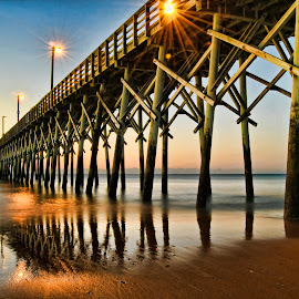 Moring's first light reflects on the pier by Steve Brooks - Landscapes Sunsets & Sunrises