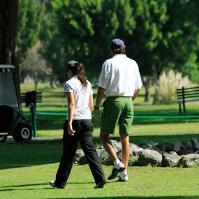 golfers by Cristobal Garciaferro Rubio - People Couples ( club, golf, lake, golfers, country )