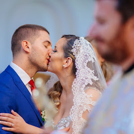 First kiss by Bugarin Dejan - Wedding Bride & Groom ( expression, priest, indoor, church, colors, wedding dress, orthodox, people, love, kiss, make up, happy, wedding, serbia, bride, light, groom )