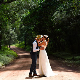 Kiss in the forest by Andrew Morgan - Wedding Bride & Groom ( tanzanianphotographer, weddingdress, kiss, nature, wedding, forest, tanzania, bride, groom )