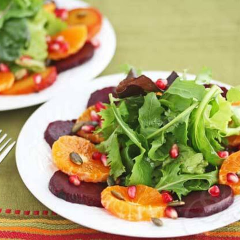 Mixed Green Salad with Roasted Beets, Orange, Pomegranate Seeds and Pumpkin Seeds