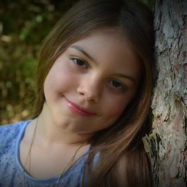 7 Years Old by Tiffany Serijna - Babies & Children Child Portraits ( innocent, raelyn, candid, fun, long, brown hair, cute, rae, sun, outside, portrait )