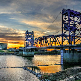 Red River Bridge by John Larson - Buildings & Architecture Bridges & Suspended Structures ( sky, reflection, city, sunset, bridge, river )