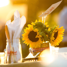 Sunflowers on a table by Greg Head - Novices Only Flowers & Plants ( light orb, sunset, event, sunflower )