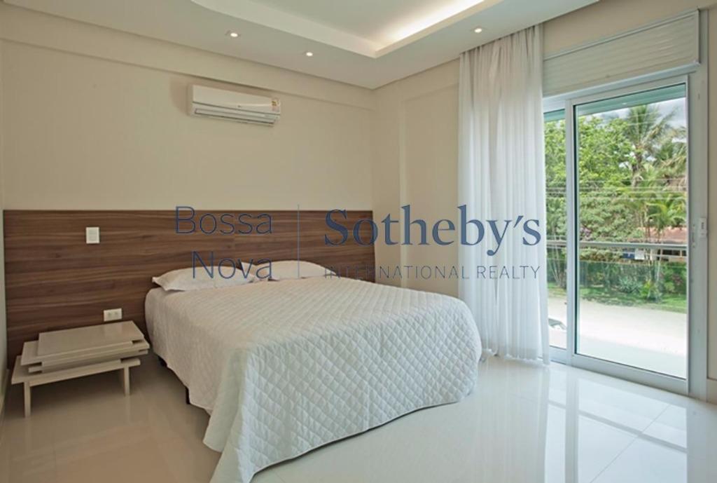 Casa de 7 dormitórios em Riviera De São Lourenço, Bertioga - SP