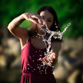 Bending Water Backwards by Kyle Re - Nature Up Close Water ( water, water drops, model, splash, creative, fine art, sunlight, people, clear, contrast, nature, color, woman, outdoor, drops, water droplets )