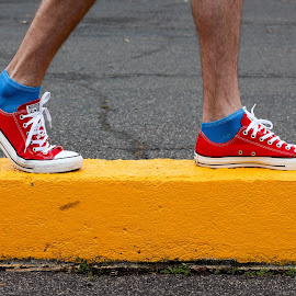 Walking on a curb by Adam Skarzynski - Artistic Objects Clothing & Accessories ( primary colors, shoes, walking, red, blue, colors, curb, yellow, sneakers, primary_colors )