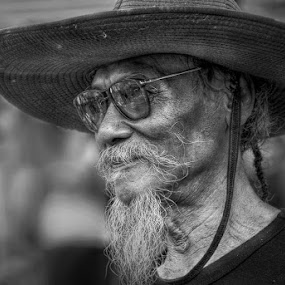 Old Man with his hat by Donny Koerniawan - People Portraits of Men