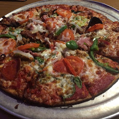 I ordered there house special pizza with everything ! (But substituted olives and mushrooms for spinach). Soooooo good!