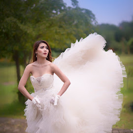 flying by Bramantya Wardana - Wedding Bride