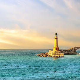 Lighthouse of Alexandria by Mohamed Mahdy - Landscapes Waterscapes ( clouds, sky, season, sunset, lighthouse, sea, alex, sunrise, seascape, landscape, egypt )