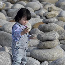 Rock Star by Kamesh Tagore - Babies & Children Children Candids ( child, pebbles, beach, boy, rocks )