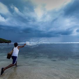 Fishingman Fishing on the Beach by Haris Sudrajat - People Street & Candids ( street, beach, fishing, fisherman, street photography )