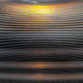 Down the Barrel of slinky by Jerry Kambeitz - Artistic Objects Toys ( slinky, orange, toy, metal, black )