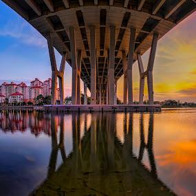 Parallel worlds by Gordon Koh - Buildings & Architecture Bridges & Suspended Structures ( reflection, under, still, architecture, singapore, city, urban, over, blue sky, vista, peace, sunrise, bridge, river, tanjong rhu,  )